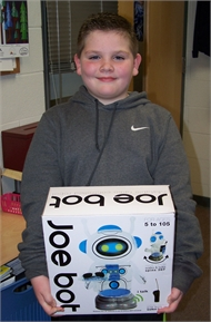 North Magoffin Elementary student Alex Holbrook is the lucky winner of Joe Bot the robot as part of SchoolStore.com Email Campaign