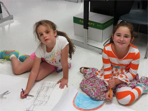 You can tell Heritage Day is right around the corner.  Second graders Sidney Salyer and Zoey Fry at Salyersville Grade School are busy working on their posters for the county wide competition.