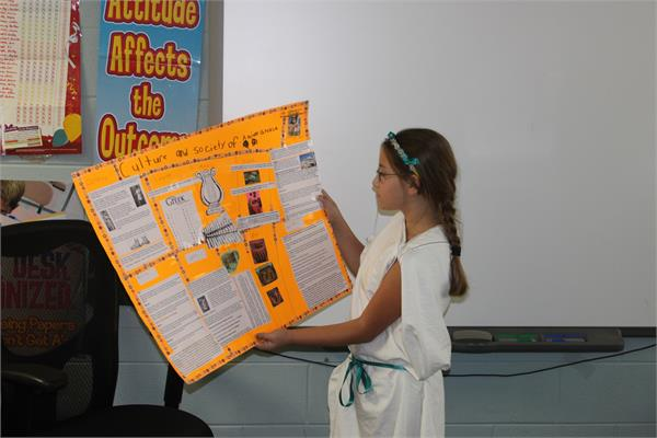 Students in Pam Howard's fifth grade class at South Magoffin recently researched a country of their choice. Danielle Auxier researched Greece and presently her research dressed in ancient Greece attire.