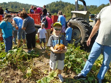The Children Took A Hayride To Pick Pumpkins In Field Enjoyed Nice Lunch Under Party Tent And Played On Playground