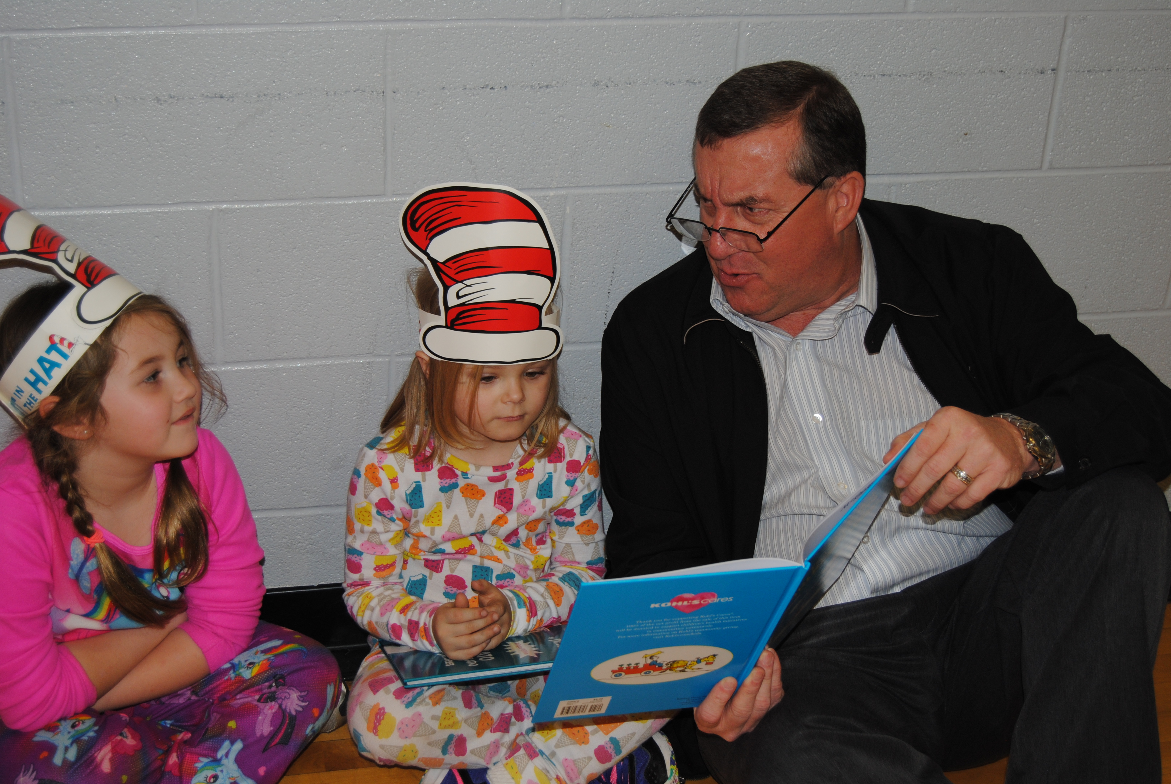 Superintendent Mr. Helton reads to NME students