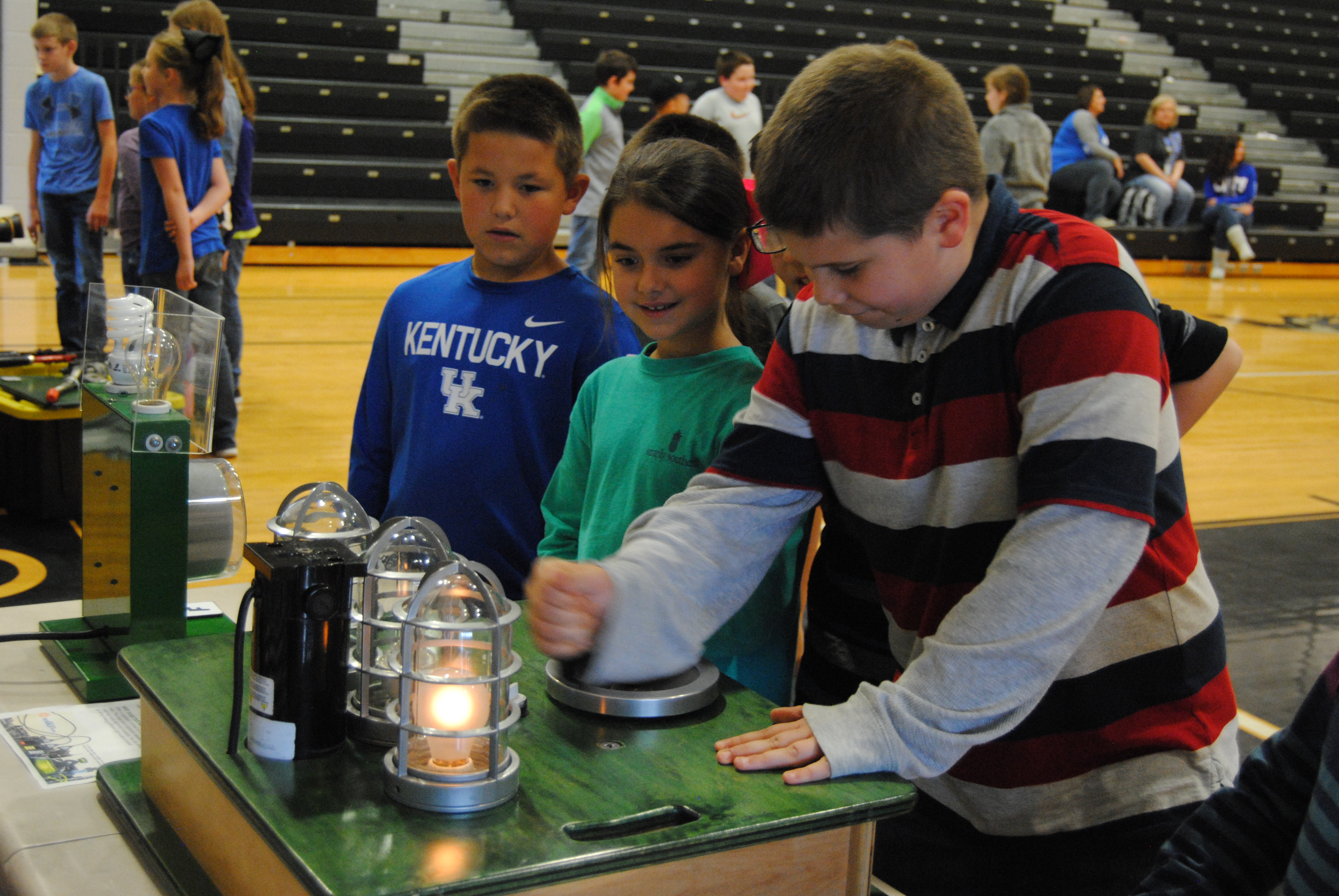Students learn about electricity consumption from Captain Current