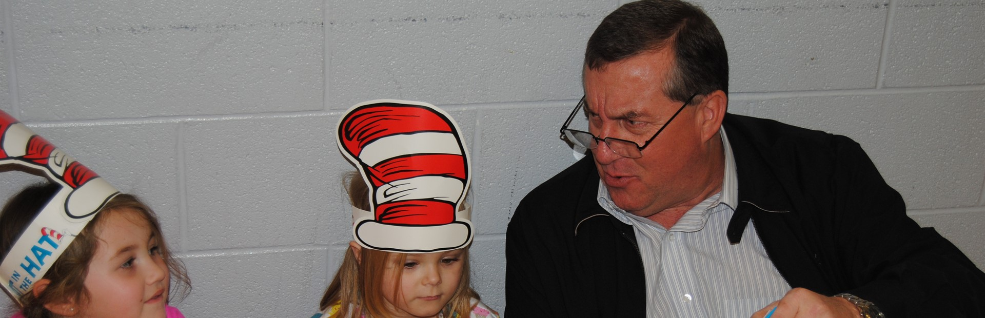 Magoffin County Schools Superintendent Scott Helton reads to North Magoffin Elementary kindergarten students during Read Across America Week.